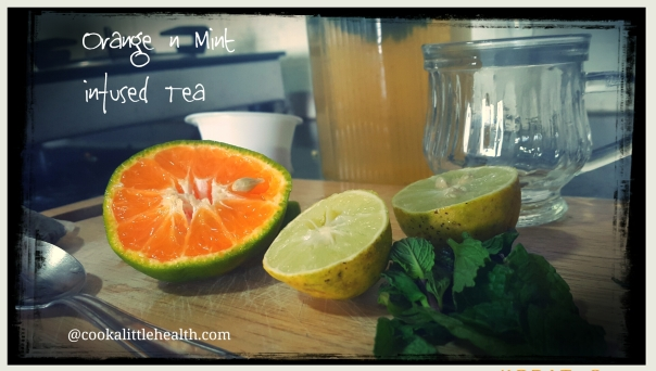 Green tea infused with fresh mint leaves and orange.